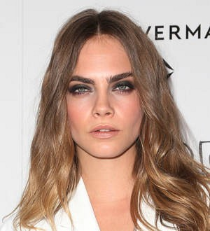 Cara Delevingne laughs off love split by taking girlfriend to premiere