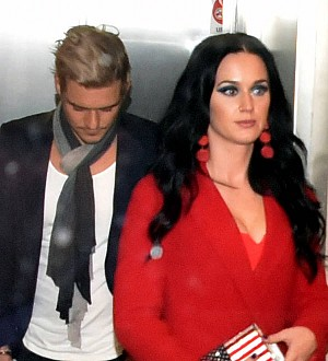 Katy Perry and Orlando Bloom dismiss split rumors in coordinating onesies