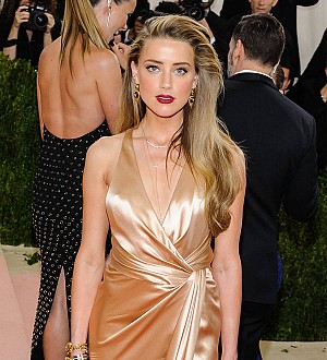 Amber Heard parties with Margot Robbie after divorce settlement