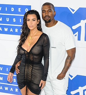 Kim Kardashian is sleeping next to husband Kanye West in hospital - report