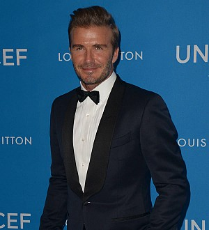David Beckham shows off angelic new tattoo