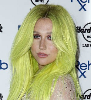 Kesha laughs off butt implant speculation