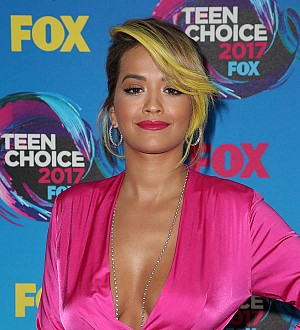 Rita Ora helps out at hurricane relief shelter