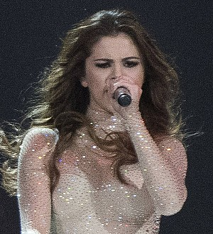 Selena Gomez follows ex Justin Bieber with stage fall