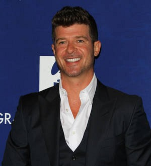 Robin Thicke stunned by dad's sex song confession