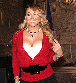 Choir threatens to sue Mariah Carey