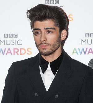 Sick Zayn Malik exits One Direction's final Australian gig early