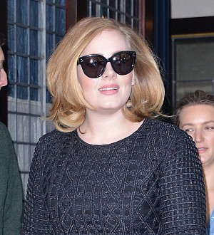Adele tops U.S. album chart for the second week with record-breaking sales