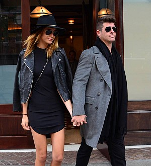 Robin Thicke's girlfriend fuels rumors the couple has wed