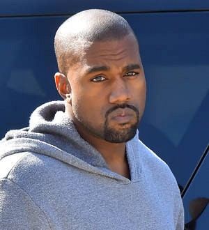 Kanye West settles paparazzi suit with an apology