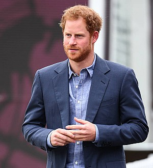 Prince Harry condemns 'wave of abuse' aimed at girlfriend Meghan Markle