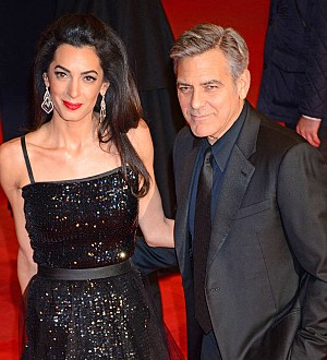 Amal Clooney joins father-in-law in Spain for business conference