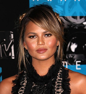 Tyra Banks tips red wine on talk show co-host Chrissy Teigen