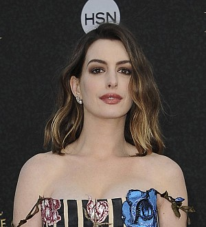 Anne Hathaway tears into James Corden in rap battle
