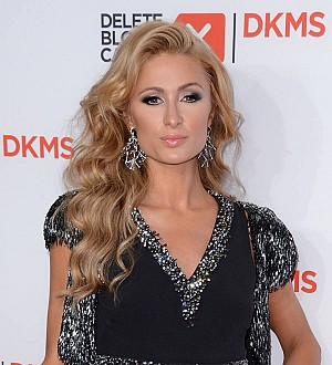 Paris Hilton apologises over orangutan picture