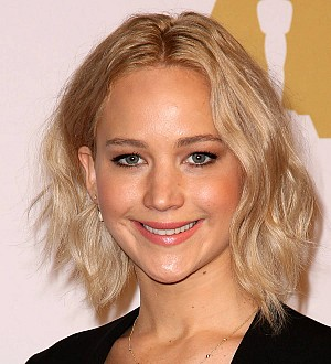 Jennifer Lawrence chants for equal pay at pre-Oscar party