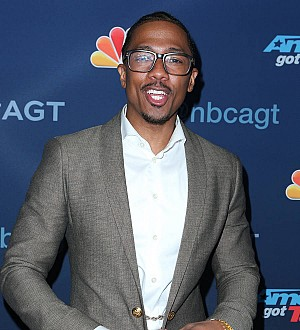 Nick Cannon's twins meet new half-sibling