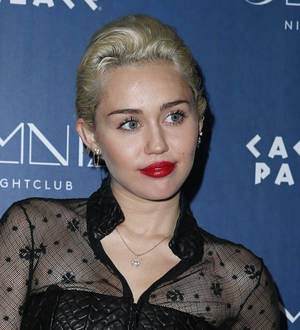 Miley Cyrus inks tattoo of Liam Hemsworth's favorite food