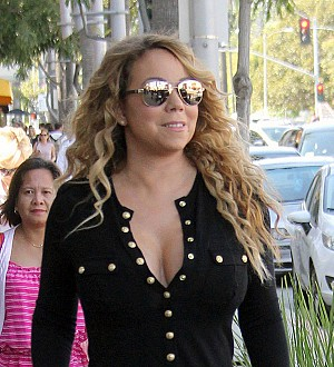Mariah Carey and Bryan Tanaka put on a united front after negative Vegas reviews