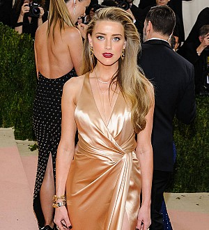 Amber Heard using divorce settlement money to help domestic violence victims