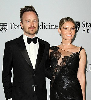 Aaron Paul stuns wife with Hong Kong airport surprise