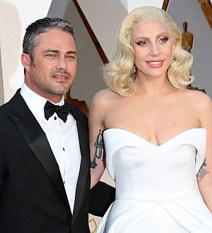 Taylor Kinney supports Lady Gaga at Chicago tour stop