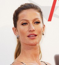 Gisele Bundchen shows off bulging belly on the beach