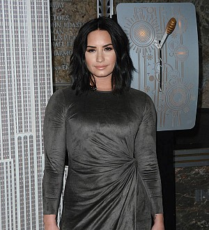 Demi Lovato gets giant lion image tattooed on hand
