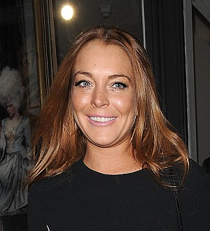 Lindsay Lohan moves in with Russian beau