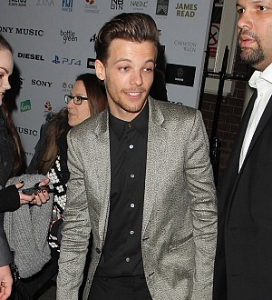Louis Tomlinson 'is quickly learning to be a dad'