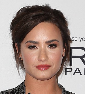 Demi Lovato: 'I have too many tattoos to act'