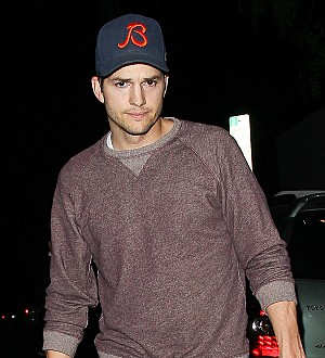 Ashton Kutcher eyes up tour with country star Thomas Rhett