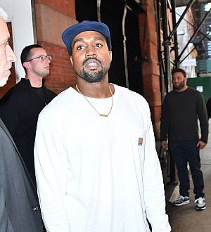 Kanye West debuts shocking bright hair in family Christmas greeting