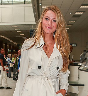Blake Lively covers up baby bump in France