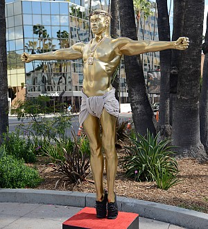 Kanye West inspires artist Plastic Jesus' False Idol sculpture
