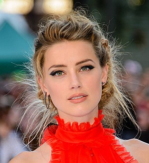 Amber Heard ordered to appear in court